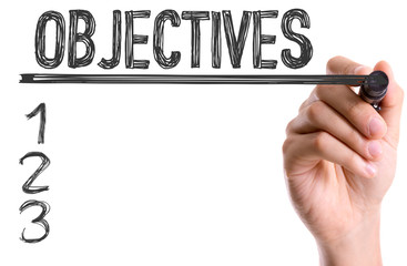Hand with marker writing: Objectives