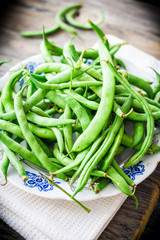 raw green beans on a gray wooden table,.healthy food