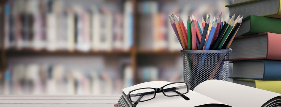Composite image of school supplies on desk
