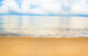 blur image of sea shore and clear blue sky  for background usage