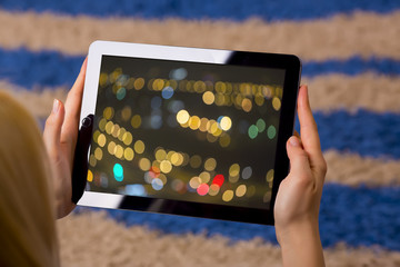 woman holding tablet in hands