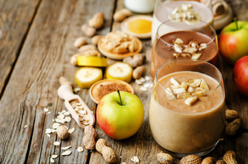 list peanut butter smoothie with chocolate, apples, banana and oats. the toning. selective focus