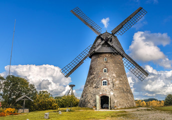 Old windmill by summer day