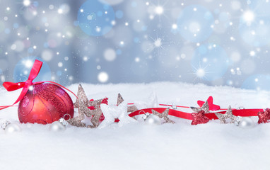 Christmas background with red baubles,snow and snowflakes, free space for text. Christmas decoration.