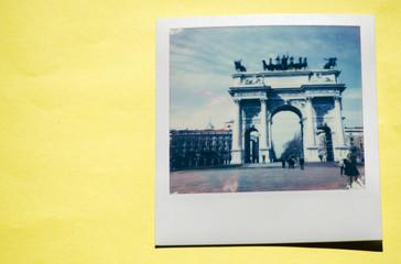 Instant photo on colored yellow background. Polaroid Milan