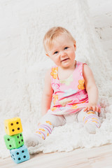 Cute baby girl playing with cubes