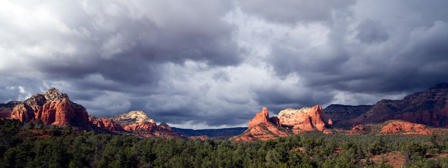 Panorama of an approaching thunderstorm at sunset behind red rocks near Sedona, Arizona