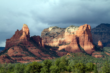 Sunset light and an approaching thunderstorm on red rocks near Sedona, Arizona