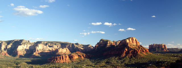 Panorama of sunset light on red rocks near Sedona, Arizona