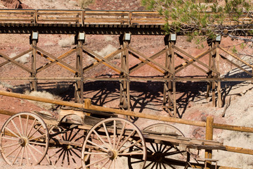 Old wagon and train trestle in Calico Ghost Town, owned by San Bernardino County, California