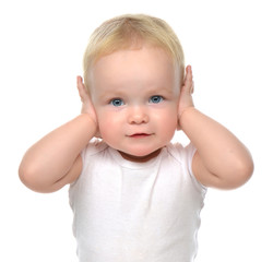 infant child baby toddler sitting closed her hands over ears and