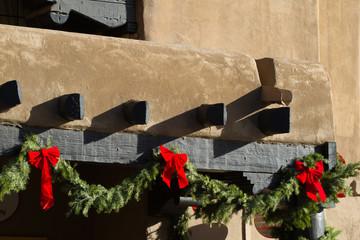 Green boughs and red bows make Santa Fe, New Mexico, festive at Christmastime