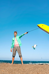 Fun on summer beach. Happy cheerful teenage girl with surfboard