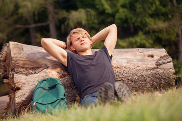 Young traveler rests time at the forest outskirt