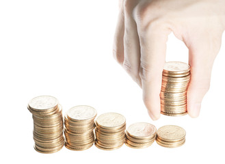 Group of stack of one dollar coins in descending order from left to right isolated on white with hand giving additional stack of dollar coins. A representation of helping hand.