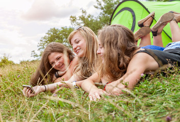 Group of friends outdoors with a smart phone