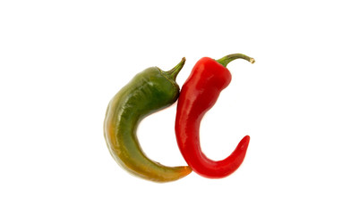 Red and green chilli peppers in file on white background