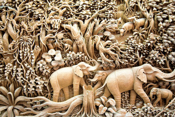 Section of an ancient mural wood carving art from Thailand