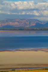 Great Salt Lake and Wasatch Mountains in evening from Antelope Island State Park in Utah