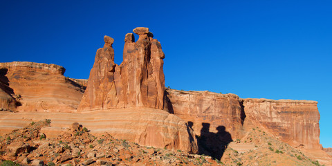 Panorama with shadow of The Three Gossips in Arches National Park in Utah