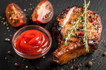 Grilled pork chop and steamed vegetables