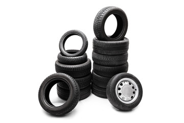 Car tires piled up in two separate stacks