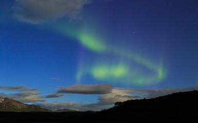 Aurora borealis over the mountains in Iceland.