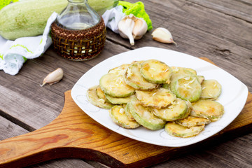 Fried zucchini with garlic in a bowl on a table