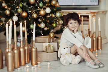 Christmas, celebration, holiday, xmas concept - happy little gir