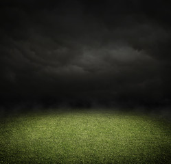 Soccer or football field at night with copy space