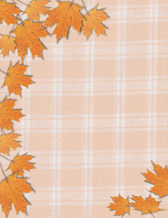 Photo frame of fall autumn maple leaves on an orange plaid background for Halloween Thanksgiving
