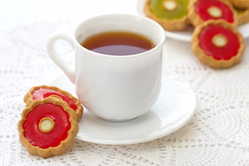 Cup of tea and colorful cookies