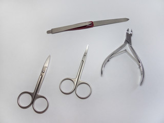 manicure set: nail Nipper, straight scissors; cuticle scissors (nail scissors bent) and nailfile