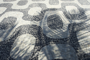 Ipanema Beach sidewalk tiles Rio de Janeiro with palm tree shadows