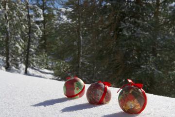 Christmas balls in a romantic snowy landscape