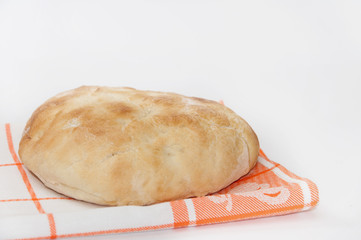 Hot domestic flat bread on a kitchen cloth