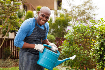 young african man watering plants