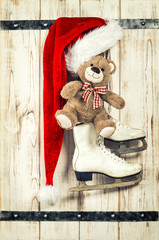 Red hat, Teddy Bear and ice skates. Vintage christmas decoration