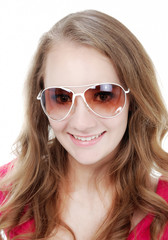 young woman with long curly hair in sunglasses