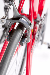 Professional Road Bike Brakes Close Up Against  White