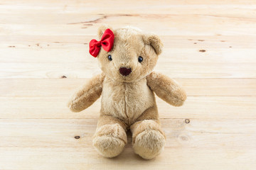 Classic teddy bear red bow toy.