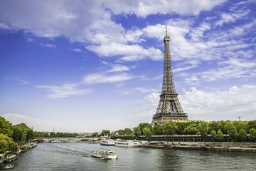 Eiffel Tower with barge on Seine River