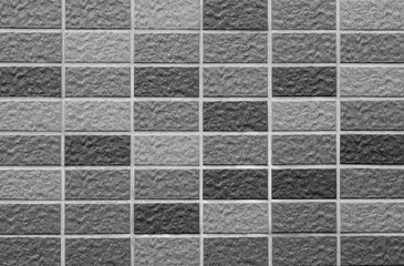 Black stone tile wall texture and background
