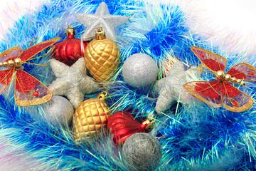 Christmas ornaments, stars, cones, balls, tinsel.