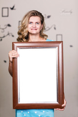 Happy woman holding portrait frame