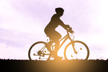 Silhouette of the cyclist riding a mountain bike.
