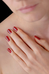 Young beauty with lacquered red nails