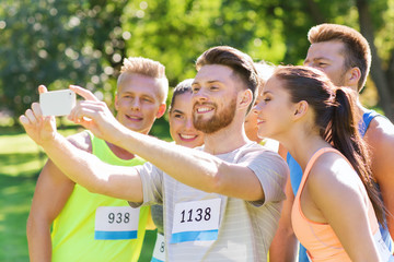 teenage sportsmen taking selfie with smartphone