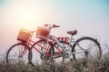 beautiful landscape image with two bicycle at sunset ; vintage f