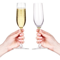 Hand with glasses of champagne isolated on white